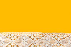 Beautiful elegant sewing crafts hobbies fashion clothing background with white cotton lace border on bright yellow backdrop. Poster streamer placeholder stock photos
