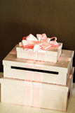 Beautiful and elegant wedding gifts in white boxes with pink rib. Bons closeup royalty free stock photos
