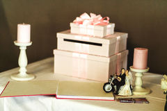 Beautiful and elegant wedding gifts in white boxes with pink rib. Bons closeup Royalty Free Stock Images