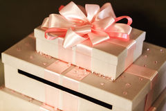 Beautiful and elegant wedding gifts in white boxes with pink rib. Bons closeup stock images