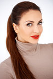 Beautiful elegant woman. Head and shoulders portrait of a beautiful elegant woman with neatly tied long brunette hair and red lipstick isolated on white stock photo