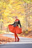 Beautiful elegant woman in autumn forest Royalty Free Stock Images