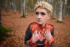 Beautiful elegant woman in autumn forest Stock Images