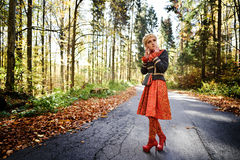 Beautiful elegant woman in autumn forest Royalty Free Stock Photos