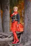 Beautiful elegant woman in autumn forest Royalty Free Stock Photo