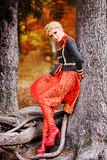 Beautiful elegant woman in autumn forest Royalty Free Stock Image