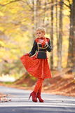 Beautiful elegant woman in autumn forest Royalty Free Stock Photography