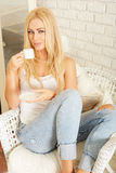 Beautiful elegant woman barefoot drinking coffee Royalty Free Stock Image