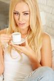 Beautiful elegant woman barefoot drinking coffee Stock Image