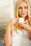 Beautiful elegant woman barefoot drinking coffee Royalty Free Stock Images