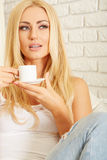 Beautiful elegant woman barefoot drinking coffee Stock Photos