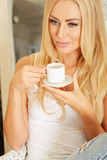 Beautiful elegant woman barefoot drinking coffee Stock Photography
