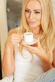 Beautiful elegant woman barefoot drinking coffee Stock Photography