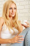 Beautiful elegant woman barefoot drinking coffee Royalty Free Stock Photography
