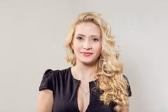 Beautiful elegant woman in black dress royalty free stock images