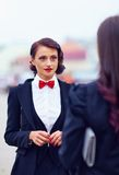 Beautiful elegant woman in black suit Stock Photography