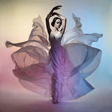Beautiful elegant woman in blowing dress. Art fashion studio photo of beautiful elegant woman in blowing dress. Flying dress. Freedom concept Royalty Free Stock Photos