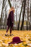 Fall fashion concept, Beautiful elegant woman in park Royalty Free Stock Photos