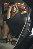 Beautiful elegant woman in a car Royalty Free Stock Image