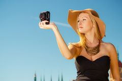 Beautiful elegant woman caught on taking pictures royalty free stock photo