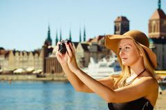 Beautiful elegant woman caught on taking pictures Stock Image