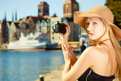 Beautiful elegant woman caught on taking pictures Stock Photography