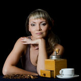 The beautiful elegant woman with a coffee cup Stock Images