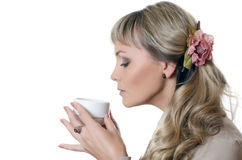 The beautiful elegant woman with a coffee cup Royalty Free Stock Photo