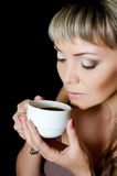 The beautiful elegant woman with a coffee cup Royalty Free Stock Photography