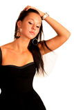 Beautiful elegant woman corrects hair. Isolated on white Royalty Free Stock Image