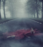 Beautiful elegant woman on a country road royalty free stock photo