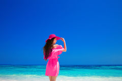 Beautiful elegant woman with hat resting on tropical beach, brun Royalty Free Stock Photo