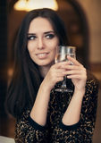Beautiful Elegant  Woman Holding a Drink Royalty Free Stock Photography