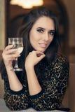 Beautiful Elegant  Woman Holding a Drink Stock Image