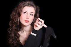 Beautiful elegant woman holding a shoe Stock Photography