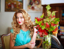 Beautiful elegant woman at home, on background of interior Royalty Free Stock Photos