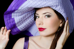 Beautiful elegant woman in a lilac hat Stock Photography
