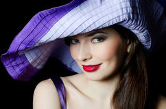 Beautiful elegant woman in a lilac hat Royalty Free Stock Photos