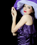 Beautiful elegant woman in a lilac hat Royalty Free Stock Photography