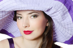Beautiful elegant woman in a lilac hat Stock Images