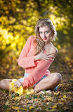Beautiful elegant woman with long legs in autumn park Royalty Free Stock Images