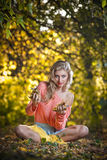 Beautiful elegant woman with long legs in autumn park Royalty Free Stock Photo
