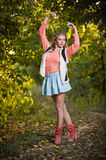 Beautiful elegant woman with long legs in autumn park . Royalty Free Stock Photos