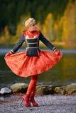 Beautiful elegant woman by mountain lake in autumn Royalty Free Stock Photos