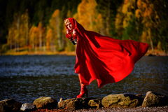Beautiful elegant woman by mountain lake in autumn Royalty Free Stock Images