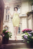 Beautiful elegant woman. In pale yellow dress Stock Image