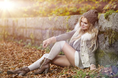 Beautiful elegant woman. In a park in autumn Royalty Free Stock Image