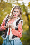 Beautiful elegant woman with pink sweater in autumn park . Stock Photography