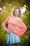 Beautiful elegant woman in pink sweater in autumn park . Royalty Free Stock Photos