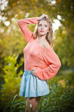Beautiful elegant woman in pink sweater in autumn park . Royalty Free Stock Photo